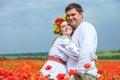 Happy ukrainian couple in blossom poppies field Royalty Free Stock Photo