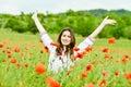 Happy ukrainian girl in poppy field Royalty Free Stock Photography