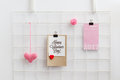 Happy Valentine`s Day card on a wall grid organizer. Royalty Free Stock Photo