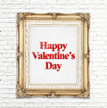 Happy Valentine's Day word in golden vintage photo frame on white brick wall,Love concept. Royalty Free Stock Photo