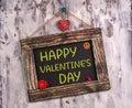 Happy valentine`s day written on Vintage sign board