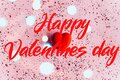 Happy Valentine's day text on pink background with hearts. Holiday concept Royalty Free Stock Photo
