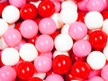 Happy valentines candy background day themed red pink and white gumball Royalty Free Stock Photos