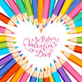 Happy Valentines Day card. Heart frame of colored pencils