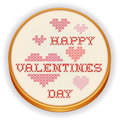 Happy valentines day cross stitch embroidery retro wood hoop with needlework sewing design with big red and pink hearts on white Royalty Free Stock Images
