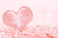 Happy Valentines day greeting card, close up on a pink ice heart Royalty Free Stock Photo