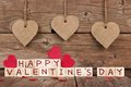 Happy Valentines Day wooden blocks with heart decor on wood Royalty Free Stock Photo