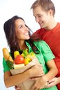 Happy vegetarians couple of healthy eating followers looking at one another Royalty Free Stock Photography