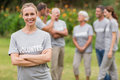 Happy volunteer looking at camera with arms crossed on a sunny day Royalty Free Stock Image