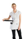 Happy waitress with serving tray portrait of standing isolated over white background Stock Photo