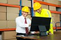 Happy Warehouse Worker And Manager Using Computer Royalty Free Stock Photo