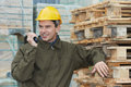 Happy warehouse worker with radio transmitter Royalty Free Stock Photos