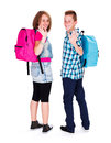 Happy waving teens students smiling and with backpack on Royalty Free Stock Image
