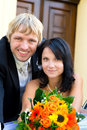 Happy wedding couple in love bridal with their bouquet Stock Photo