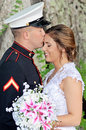 Happy wedding couple a newlywed portrait groom is military men in uniform kissing brides forehead Stock Photos