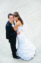 Happy wedding couple standing and embracing love people Stock Images