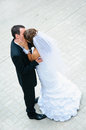 Happy wedding couple standing kissing and embracing love people Stock Photo