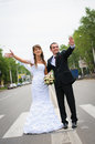 Happy wedding couple standing for a road and wave hands Royalty Free Stock Photo