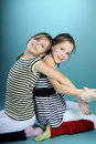 Happy white twins dancing Royalty Free Stock Photos