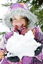 Happy winter girl holding snow Royalty Free Stock Images
