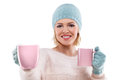 Happy winter woman holding a cup of tea with cap and gloves Stock Images