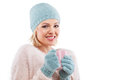 Happy winter woman holding a cup of tea with cap and gloves Royalty Free Stock Images