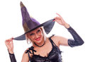 Happy witch beautiful blonde in the costume and with smile on the face isolated on white Royalty Free Stock Photography
