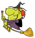 Happy witch rides broom Royalty Free Stock Photo