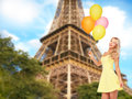 Happy woman with air balloons over eiffel tower