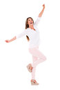 Happy woman with arms up isolated over a white background Royalty Free Stock Photography
