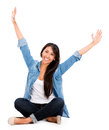 Happy woman with arms up isolated over a white background Stock Photos