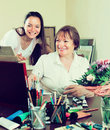 Happy woman artist with her admirer women select pictures Stock Images