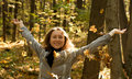 Happy woman in autumn park beautiful toss up leaves Royalty Free Stock Images