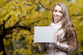 Happy woman in autumn park young casual caucasian smiling while holding sign Stock Images