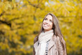 Happy woman in autumn park young casual caucasian smiling while looking up Stock Photo