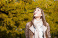 Happy woman in autumn park young casual caucasian smiling while looking up Royalty Free Stock Images