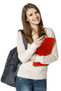 Happy woman with backpack and books with cell phone Royalty Free Stock Photo