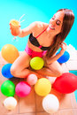 Happy woman with balloons and cocktail. Royalty Free Stock Photo