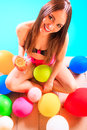 Happy woman with balloons and cocktail at poolside Royalty Free Stock Photo