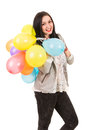 Happy woman with balloons on her shoulder standing in profile colorful isolated white background Stock Photos