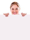 Happy woman with a banner holding and smiling isolated over white Royalty Free Stock Image