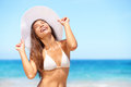 Happy woman on beach enjoying sun smiling under blue sky cheerful beautiful bikini girl tanning having fun tropical Stock Image
