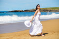 Happy woman on beach vacation playful summer dancing and having fun joyful girl relaxing summertime walk Stock Image