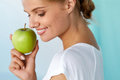 Happy Woman With Beautiful Smile, Healthy Teeth Holding Apple