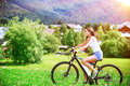 Happy woman on a bicycle Royalty Free Stock Photo