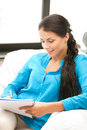 Happy woman with big notepad Stock Photo