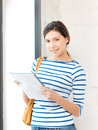 Happy woman with big notepad picture of Royalty Free Stock Photo