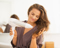 Happy woman blow drying hair in bathroom young modern Stock Photos