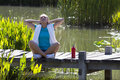 Happy woman breathing for openness and healthy wellbeing over water