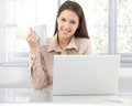 Happy woman browsing internet at home Royalty Free Stock Photo